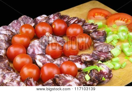 Smoked Sausage With  Celery And  A Bunch Of Small Red Tomatoes