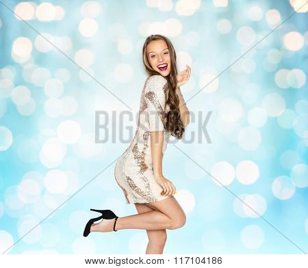 happy young woman or teen girl in fancy dress