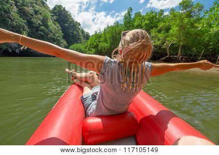 Happy tourist in kayak