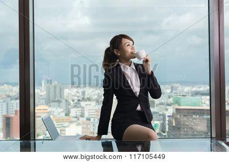 Asian business woman take a break in hotel room.
