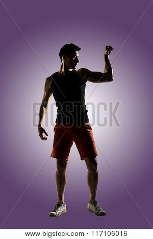 Silhouette of young male athlete, full length portrait isolated
