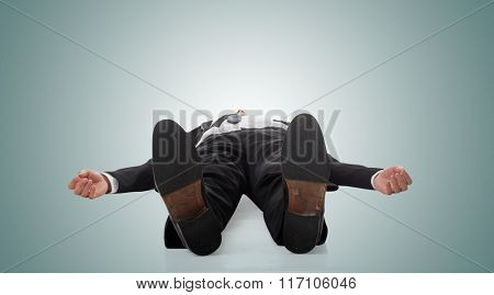 Asian businessman lying on ground, full length portrait isolated