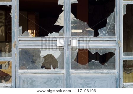 Close-up of broken windowpanes.