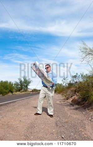Man On Deserted Road Reading Map