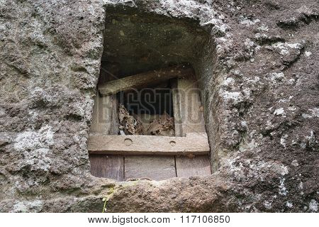 Traditional Cave Grave Carved In The Rock At Lemo. Tana Toraja, South Sulawesi, Indonesia