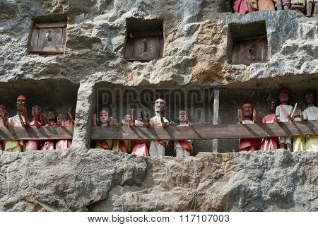 Wooden Statues Of Tau Tau. Lemo Is Cliffs Old Burial Site In Tana Toraja. South Sulawesi, Indonesia