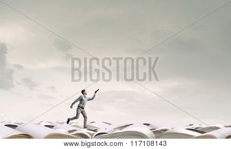Man running with book