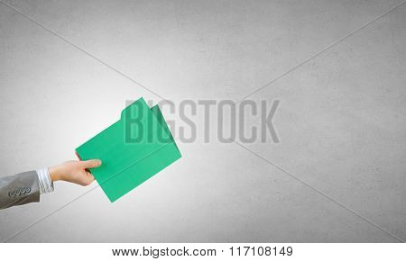 Folder sign in hand