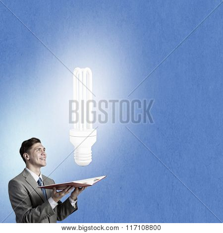 Businessman with book in hands
