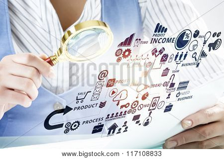 Businessperson examining business plan