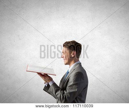 Businessman with red book
