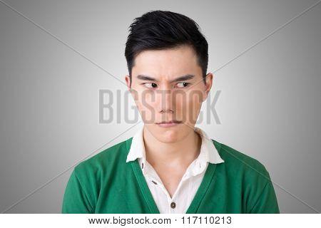 Funny facial expression, closeup Asian young man.