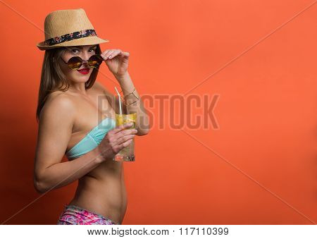 Woman In Bikini With A Cold Drink