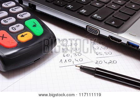 Payment Terminal, Laptop And Financial Calculations