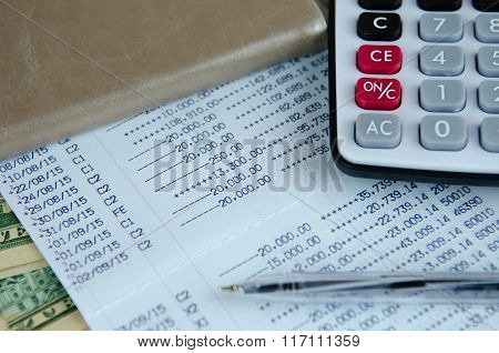 Calculator And Pen On Bank Account Passbook With Dollar Banknote, Selective Focus