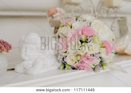 Wedding flower with Angel near flower.