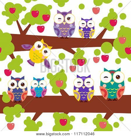 seamless pattern bright colorful owls on the branch of a tree with red apples on white background. V