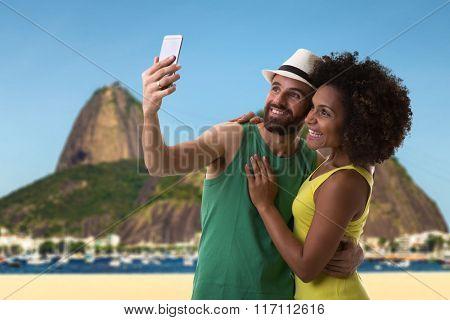 Brazilian couple taking a selfie photo in Rio de Janeiro, Brazil