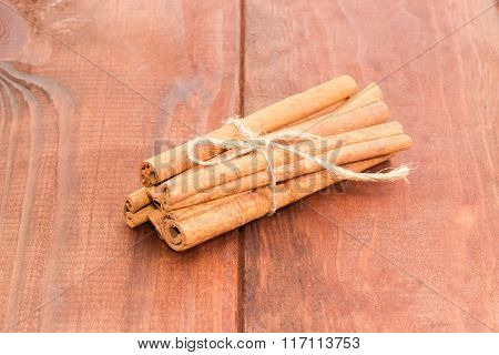 Cinnamon Sticks On A Wooden Surface