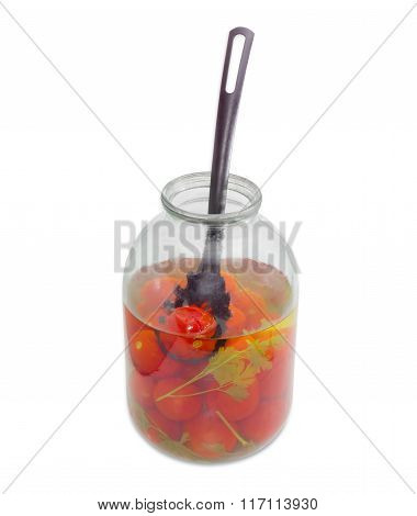 Pickled Tomatoes And Slotted Spoon In Glass Jar