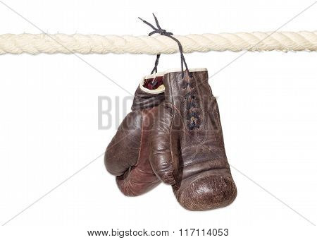 Boxing Gloves Hanging On The Rope Of A Boxing Ring