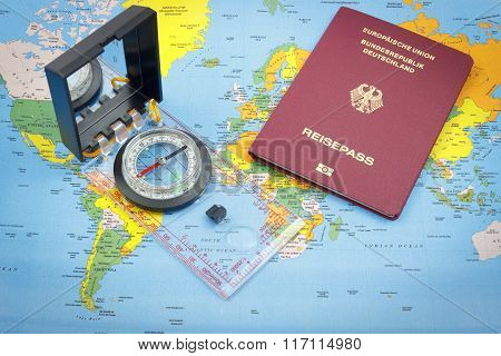 Compass and German passport on a world map