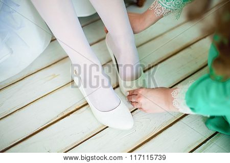 White Shoes On A White Timber Floor