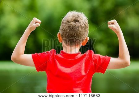 Back Of Child With Fists In The Air