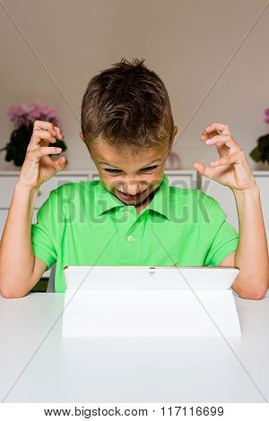 Frustrated Boy Using White Tablet