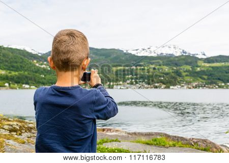 Boy Taking Picture With Digital Compact Camera