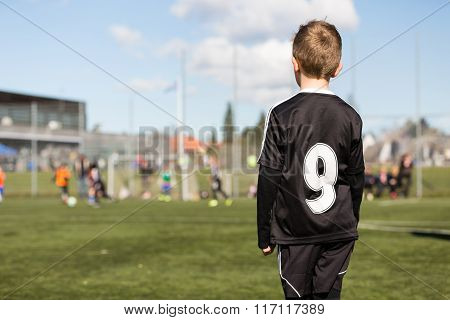 Boy Watching Youth Soccer Match