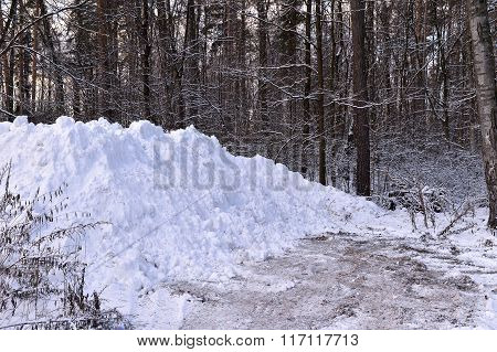 A Pile Of Snow When Clearing The Road In The Woods