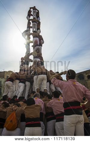 REUS, SPAIN - OCTOBER 25, 2014: Castells Performance, a castell is a human tower built traditionally