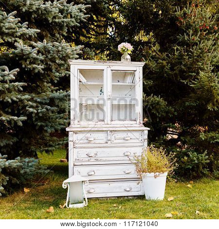 Old White Closet On A Background Of Trees Outdoors