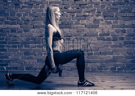 Training And Motivation - Attractive Adult Fitness Woman In Top And Leggings Performing Lunges With