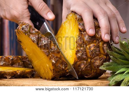 Hands Slicing  Pineapple With Knife