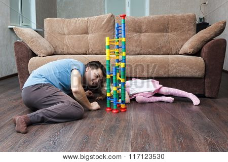 Father And Daughter Build Ball Slide Tower