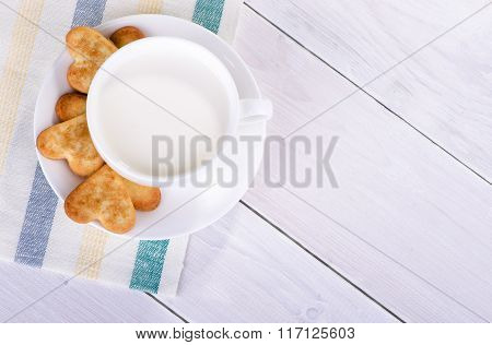 Cup With Milk And Cookies In The Shape