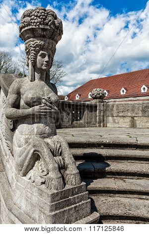 Mythological sculptures at fountain Sprudelhof in Bad Nauheim, Germany
