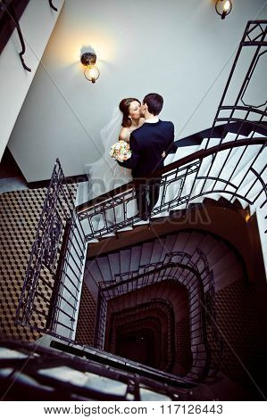 Love Young Couple Kissing On The Stairs