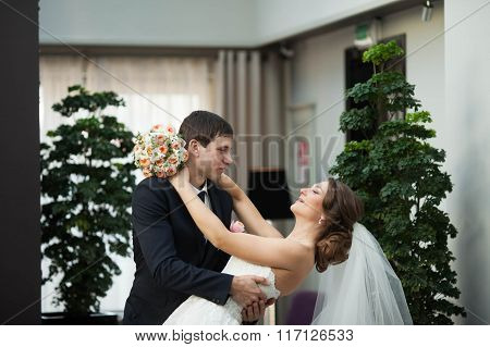 Elegant Manly Strong Groom Holds His Bride