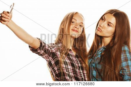 cute teenage girls making selfie isolated