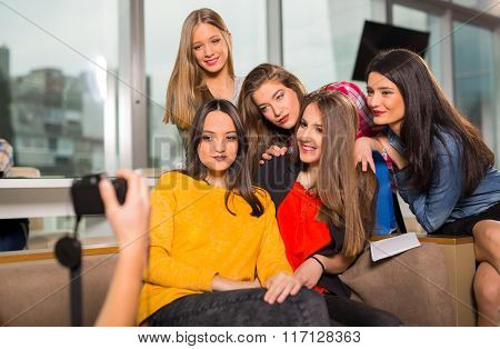 Teenager girls hanging out together in a coffee shop
