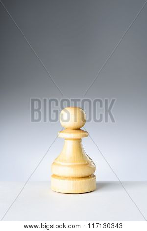 White Pawn On White Table