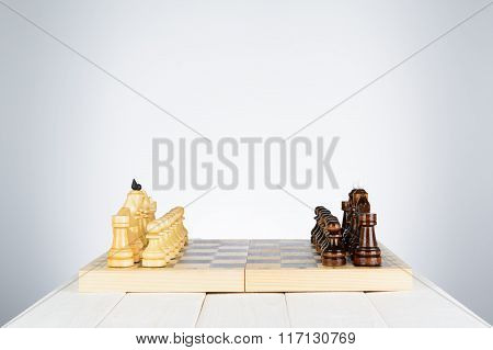 Black And White Chess Pieces On A Chessboard