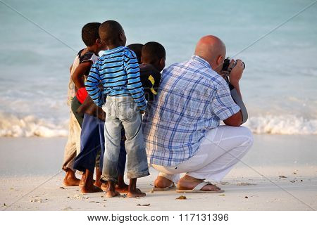 White Man With African Children