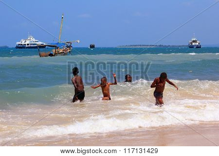 Group Of Kids Playing In The Water