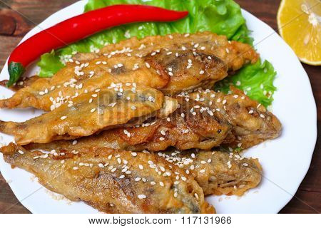 closeup of a plate with spanish boquerones fritos, battered and fried anchovies typical in Spain, on