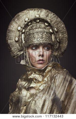Woman in gold kokoshnik head wear