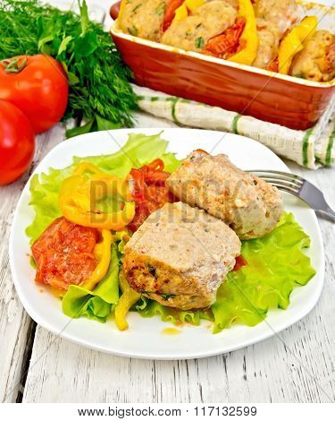 Cutlets of turkey with lettuce in plate on board